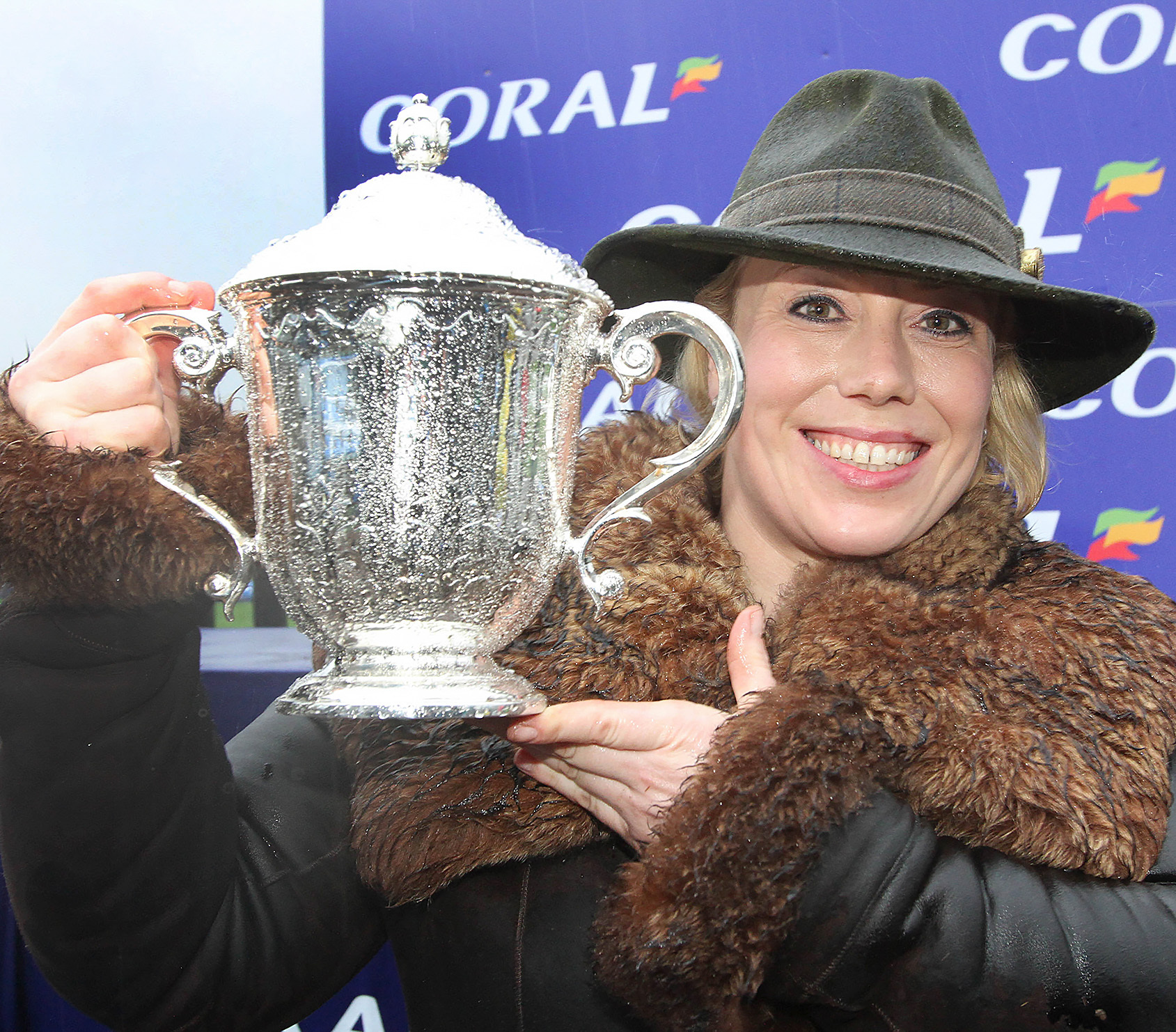 kerry lee2.jpg                    PB001-2016-56 Coral Welsh Grand National 2015 at Chepstow Racecourse held last Saturday January 9th won by Mountainous trained  by Kerry Lee from Presteigne pictured is Kerry Lee in the winners enclosure with the trophy a
