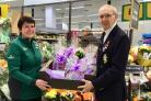 Zoe Newton, Morrison's Leominster store champion and Royal British Legion, Bromyard Branch chairman Norman Dunn