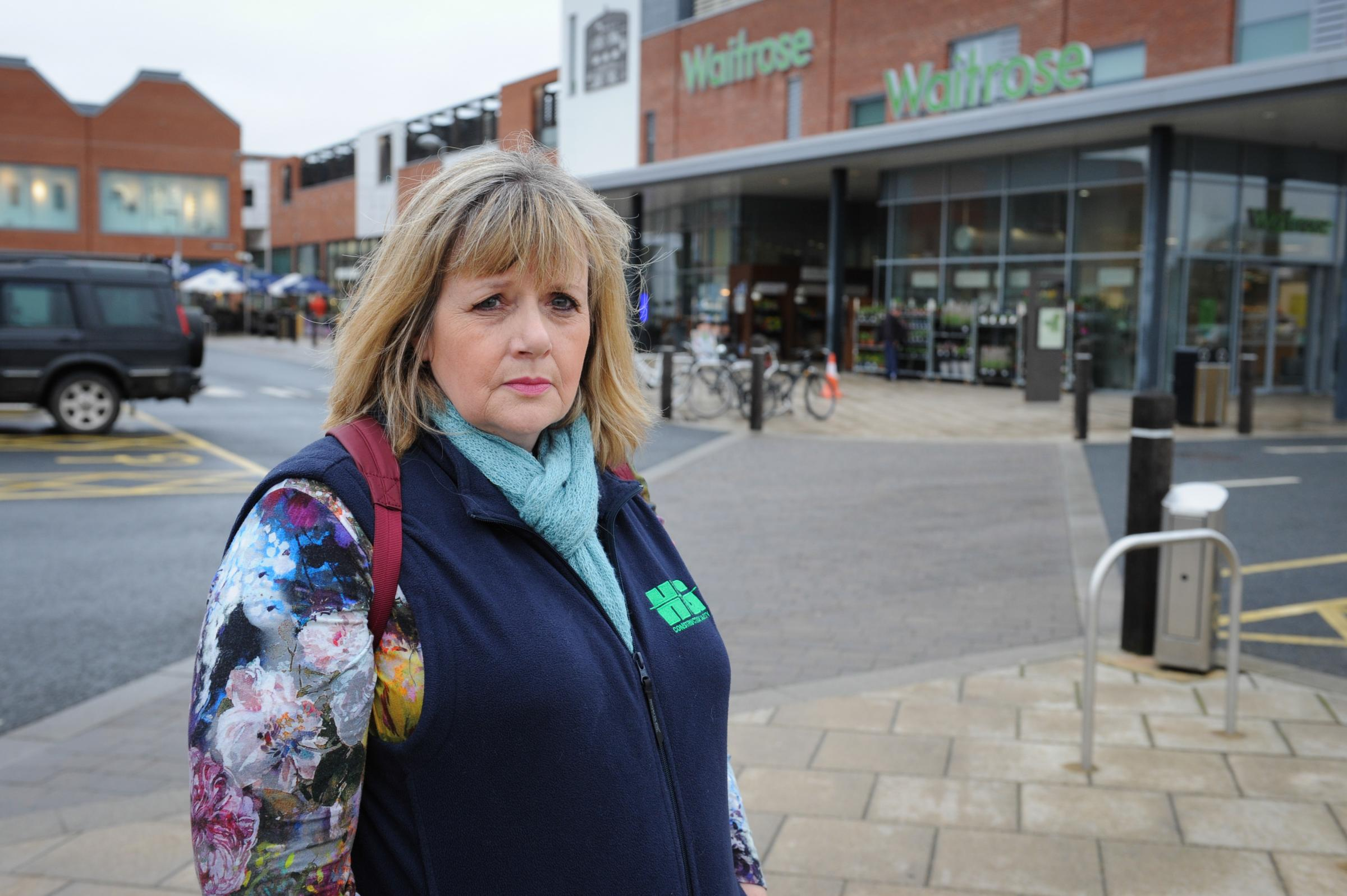 Marie-Louise Evans is concerned about the paved area outside Waitrose which looks pedestrianised but isn't. She has seen a number of near misses there. Old Market, Hereford.