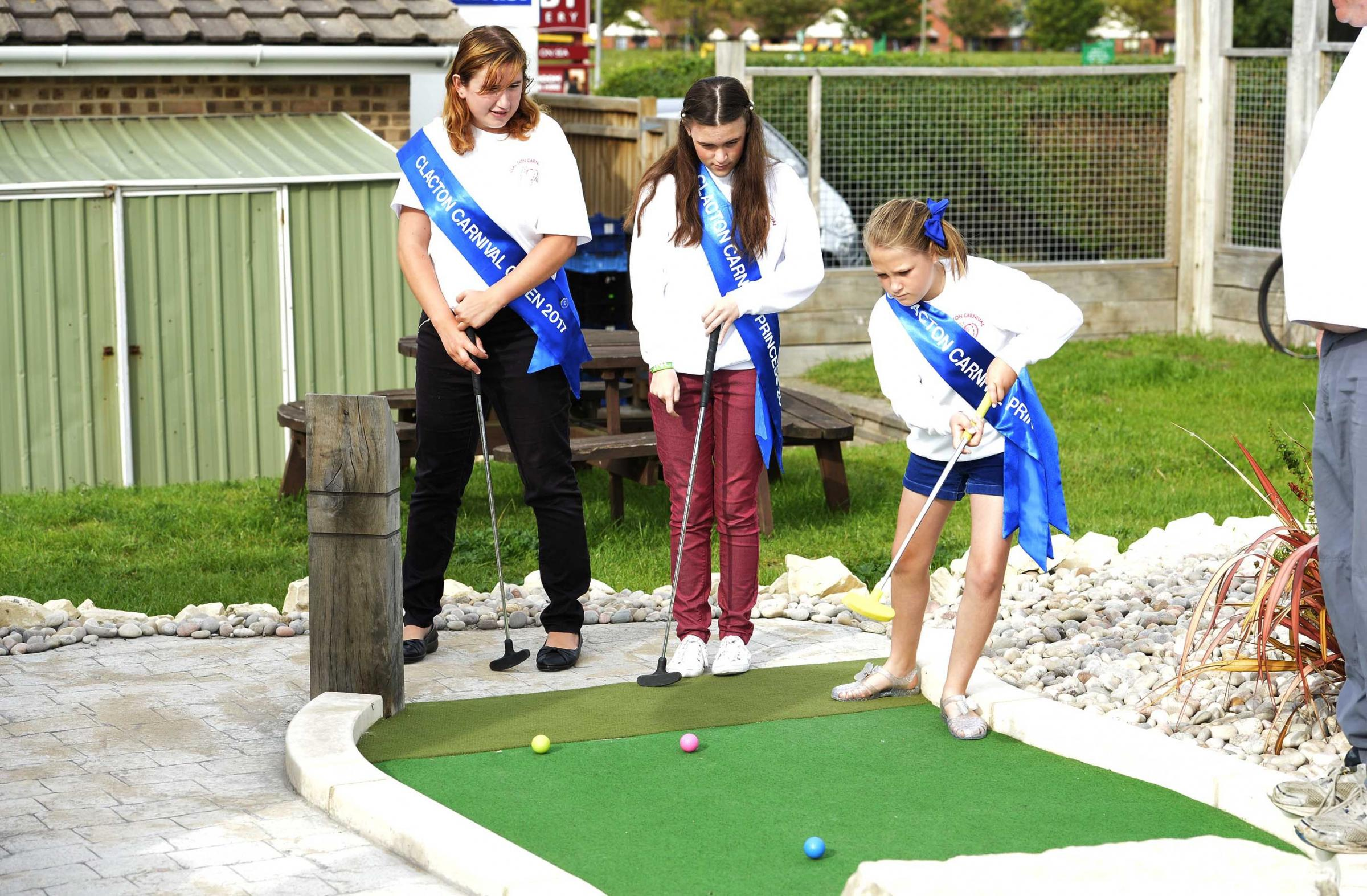 Clacton Carnival Crazy Golf.Carnival Court lead the way.Queen Louise Primmer with Princess Hannah Elborn, 12, and Kaycie Fraser, 14..