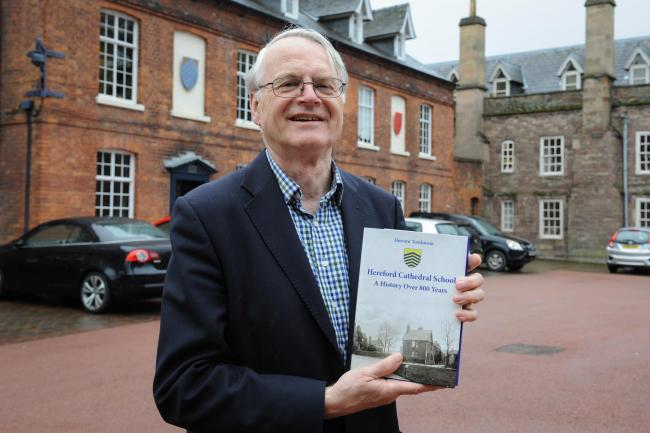 Former Headteacher Howard Tomlinson has written a book on the history of Hereford Cathedral school. Howard with his book in front of School House, the oldest building still in use at the school.