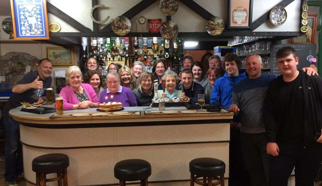 Staff and regulars at The Golden Lion raise a glass to the hospice