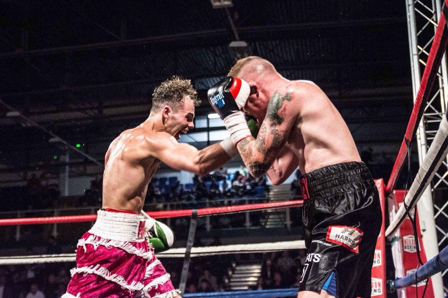 Alex Florence (left) lands a series of blows on his opponent on his way to victory