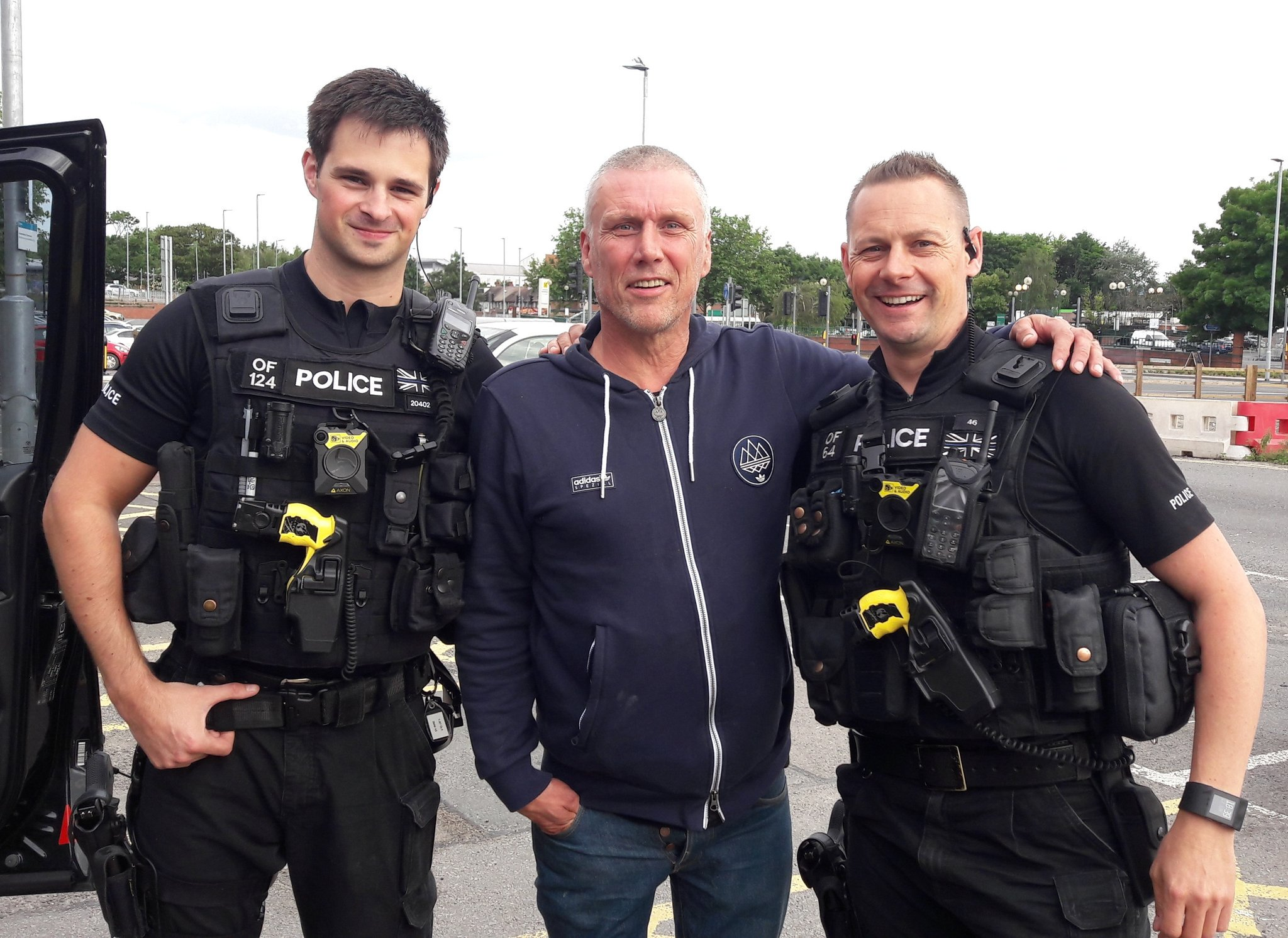 Bez, of the Happy Mondays, with two Hereford policemen. Picture: @OPUHereford