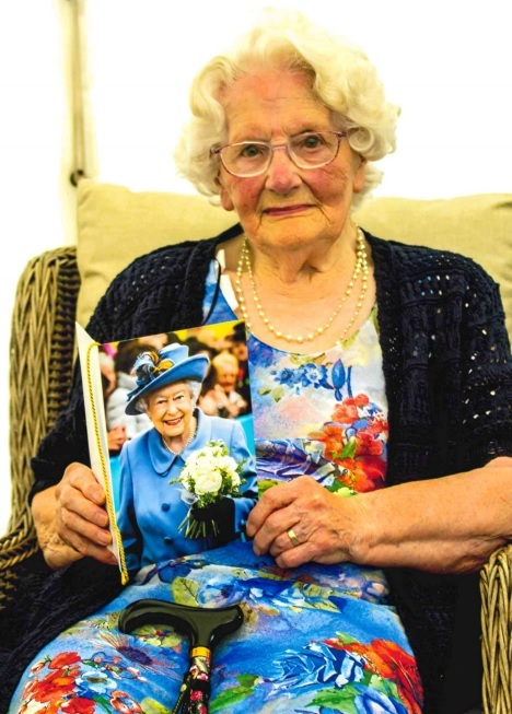 May Daniels with her 100th birthday card from the Queen.