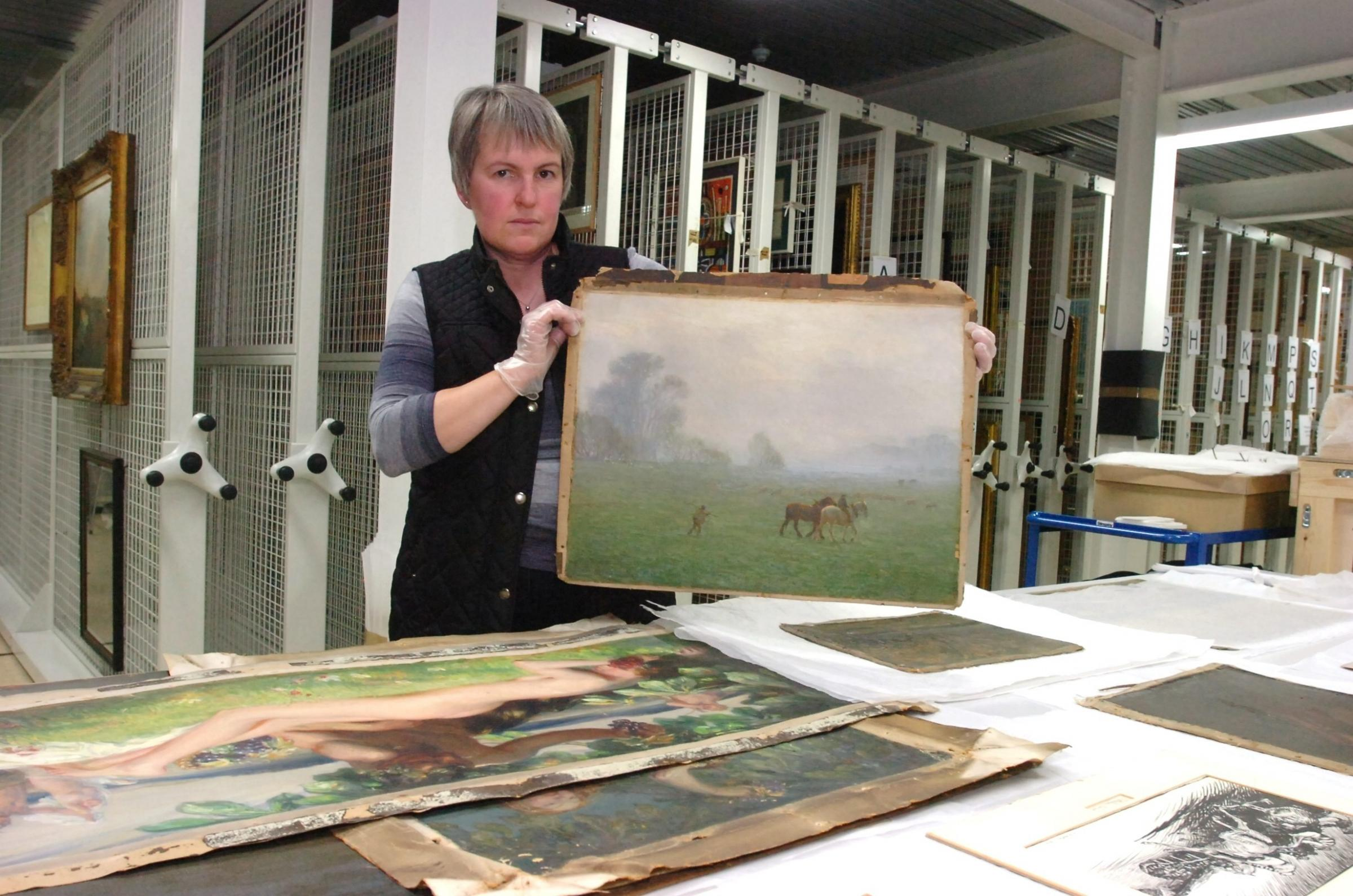 Curator Catherine Willson with some of the additions to the Brian Hatton collection in 2014. The collection of paintings was donated to Hereford's Museum Resource & Learning Centre on Friars Street. The council holds more than 4,000 pieces of f