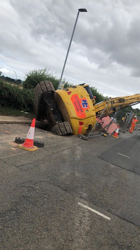 The fallen digger arm is partially obstructing Three Elms Road. Photo: Danielson Wilde