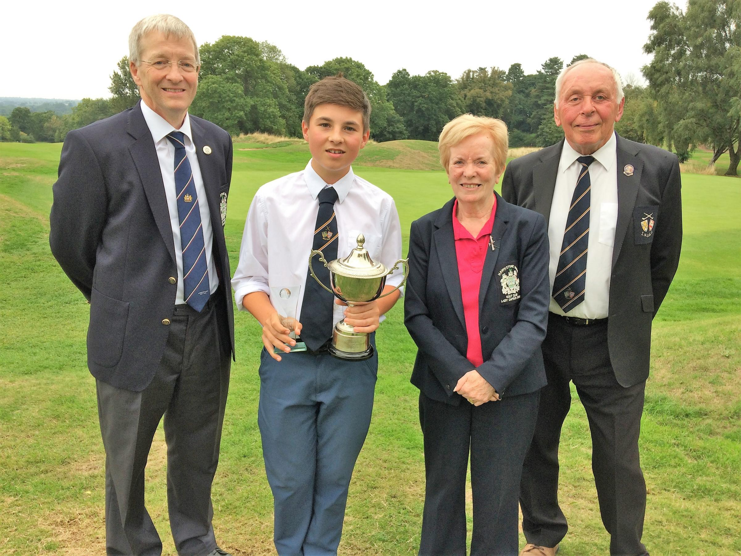 Jack Helme of The Grove Golf Club collects the winner's trophy