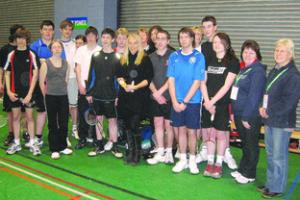Gail Emms with her medals surrounded by Herefordshire Badminton Association members.