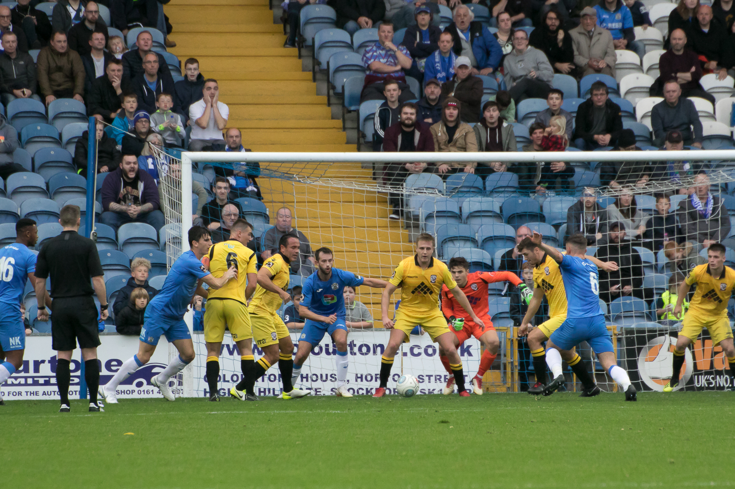 Ethan Wassall clears any danger for Hereford at Stockport. Picture: Andy Walkden