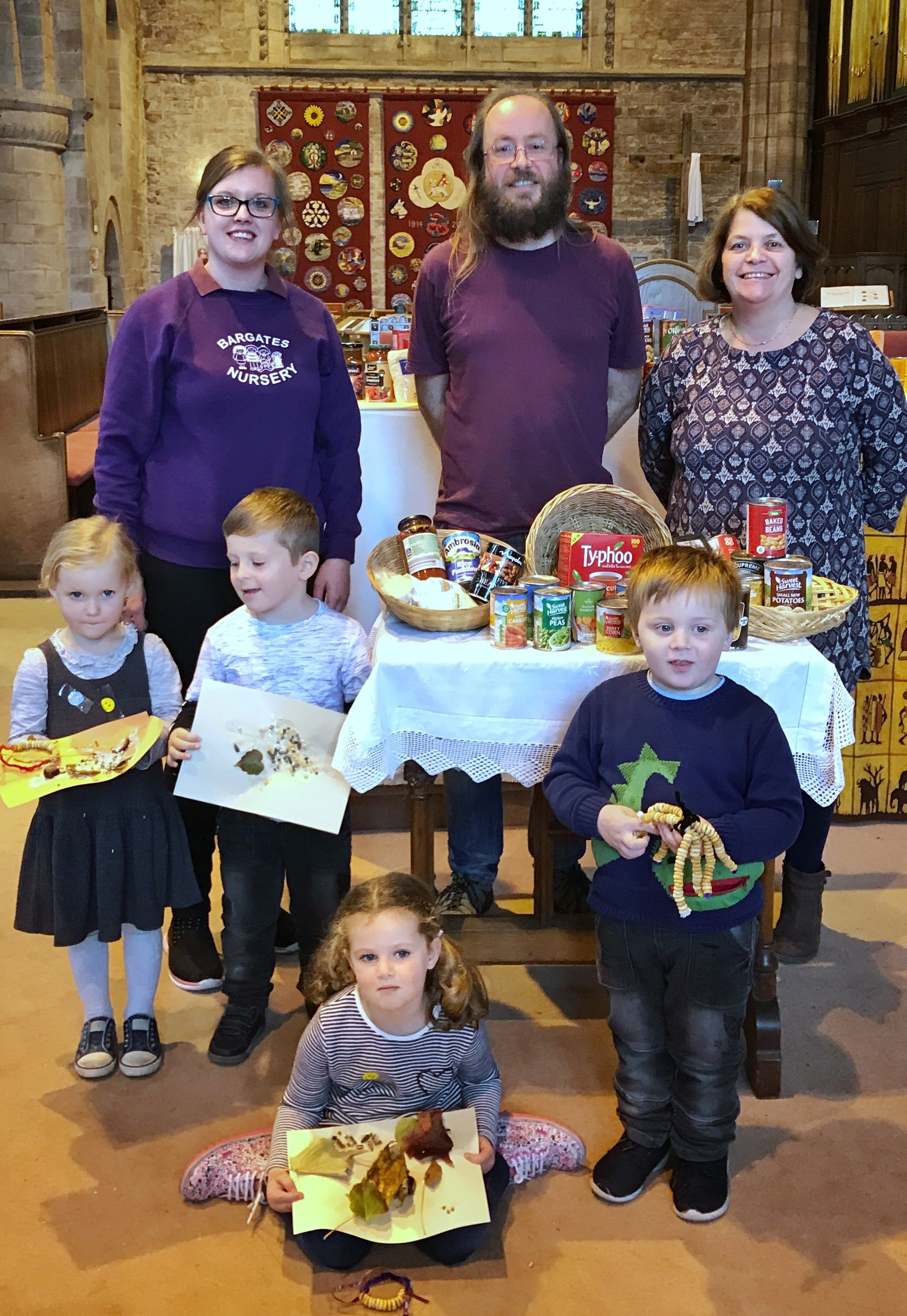 Youngsters from Bargates Nursery with David and Kathy Bland from Leominster Priory Church.