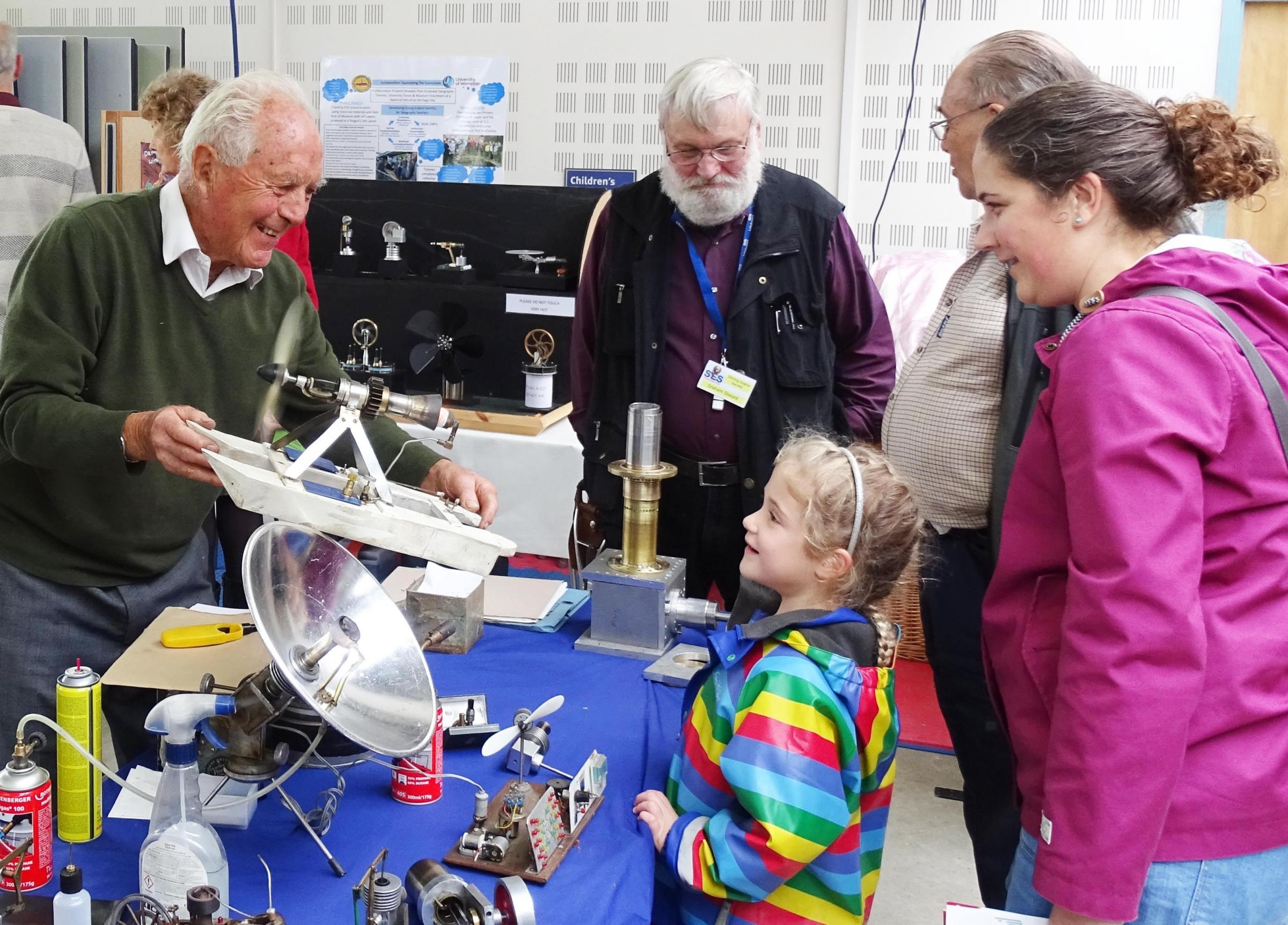 Rally organiser, Julian Wood, enthrals visitors of all ages with his working model hot air engines