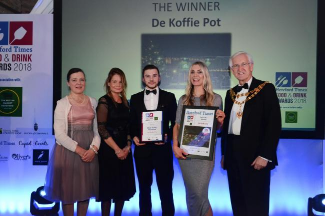 Staff from De Koffie Pot pick up their award for Best Cafe/Tearoom from Brian Wilcox, chairman of Herefordshire Council.