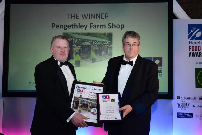 David Curtis from the Duchy of Cornwall presenting the Farm Shop award to James Hughes from Pengethley Farm Shop