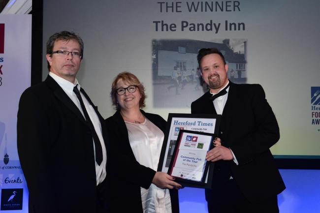 James Aubrey and Lisa Aubrey-Cosslett from the Pandy Inn collect their award from Jason Hughes of the Wobbly Brewing Company