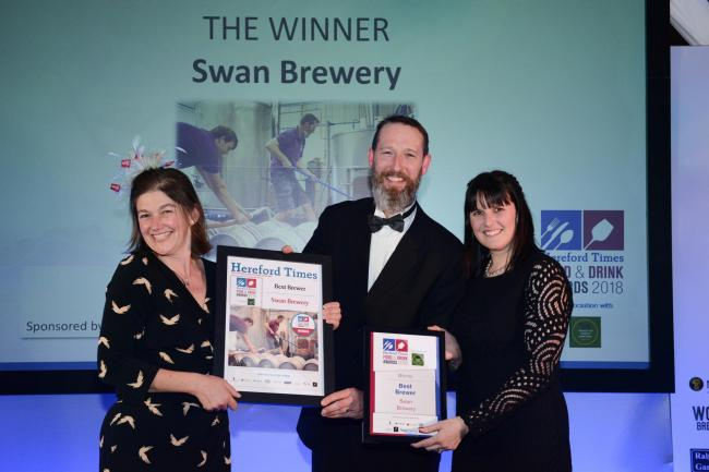 Gill Bullock and Jimmy Swan from Swan Brewery collect the Best Brewer award from Sonia Owens of NFU Mutual.