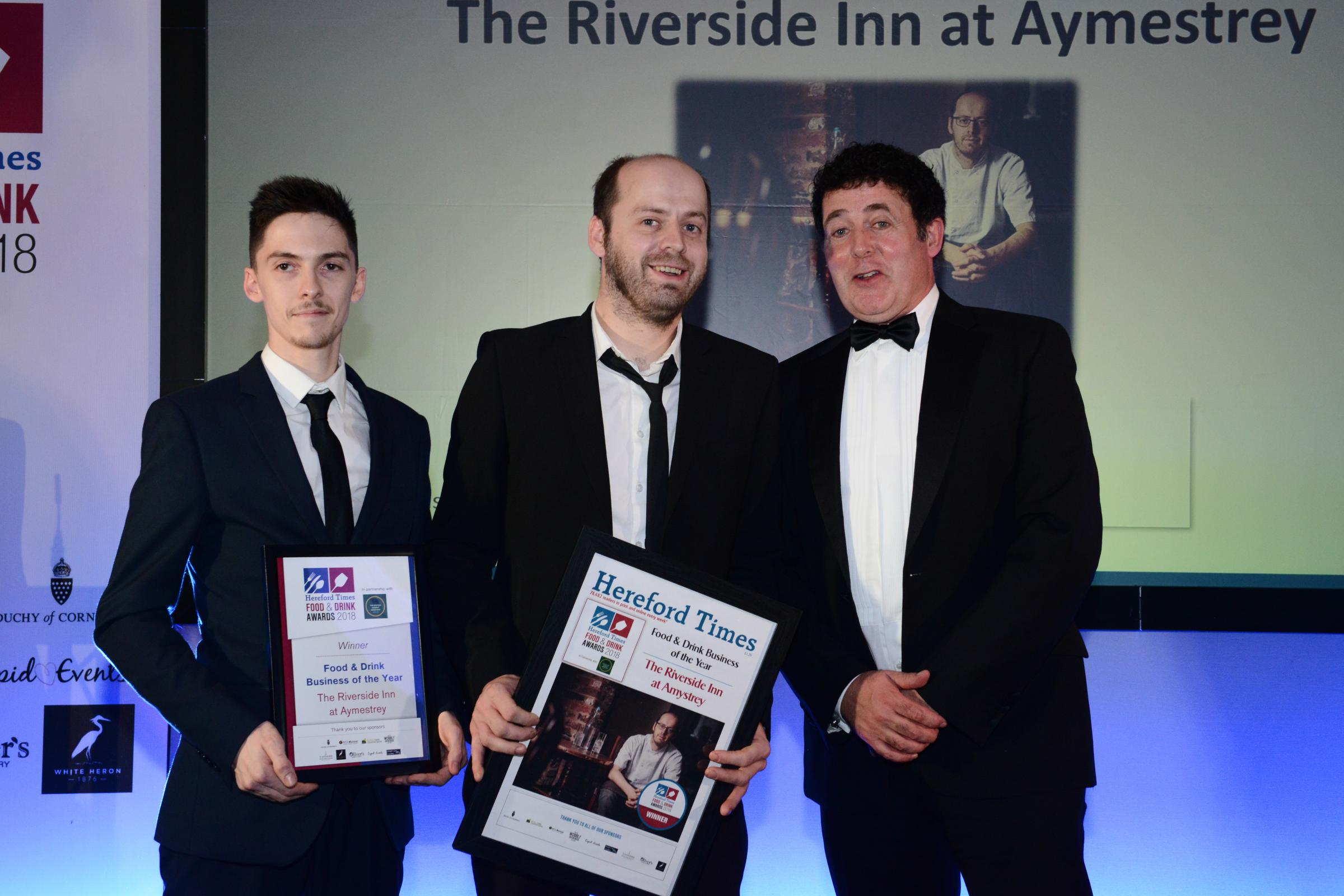 Elliott Foote and Andy Link from The Riverside Inn at Aymestrey collect the award from Darren Sockett of The Butter Market