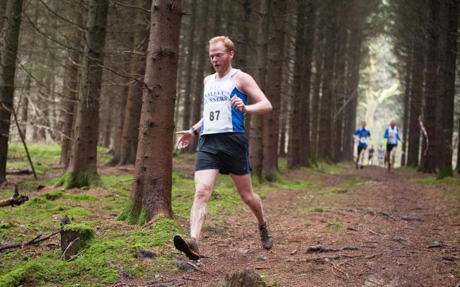 Steven Flowers pounds the track in Haugh Woods