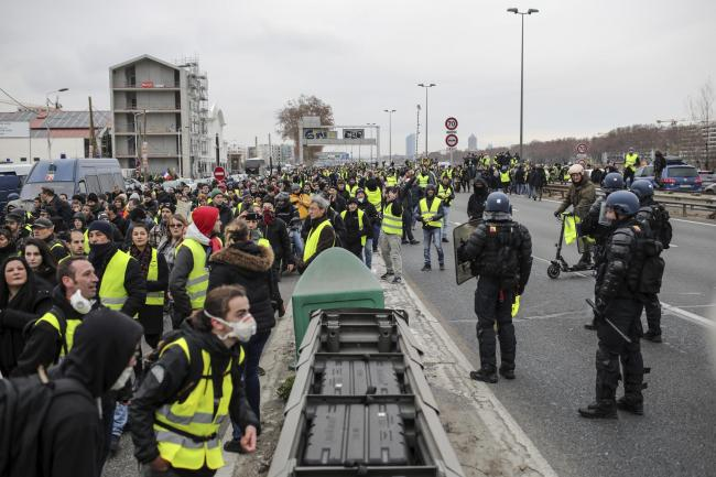 Demonstrators wearing yellow vests in Lyon