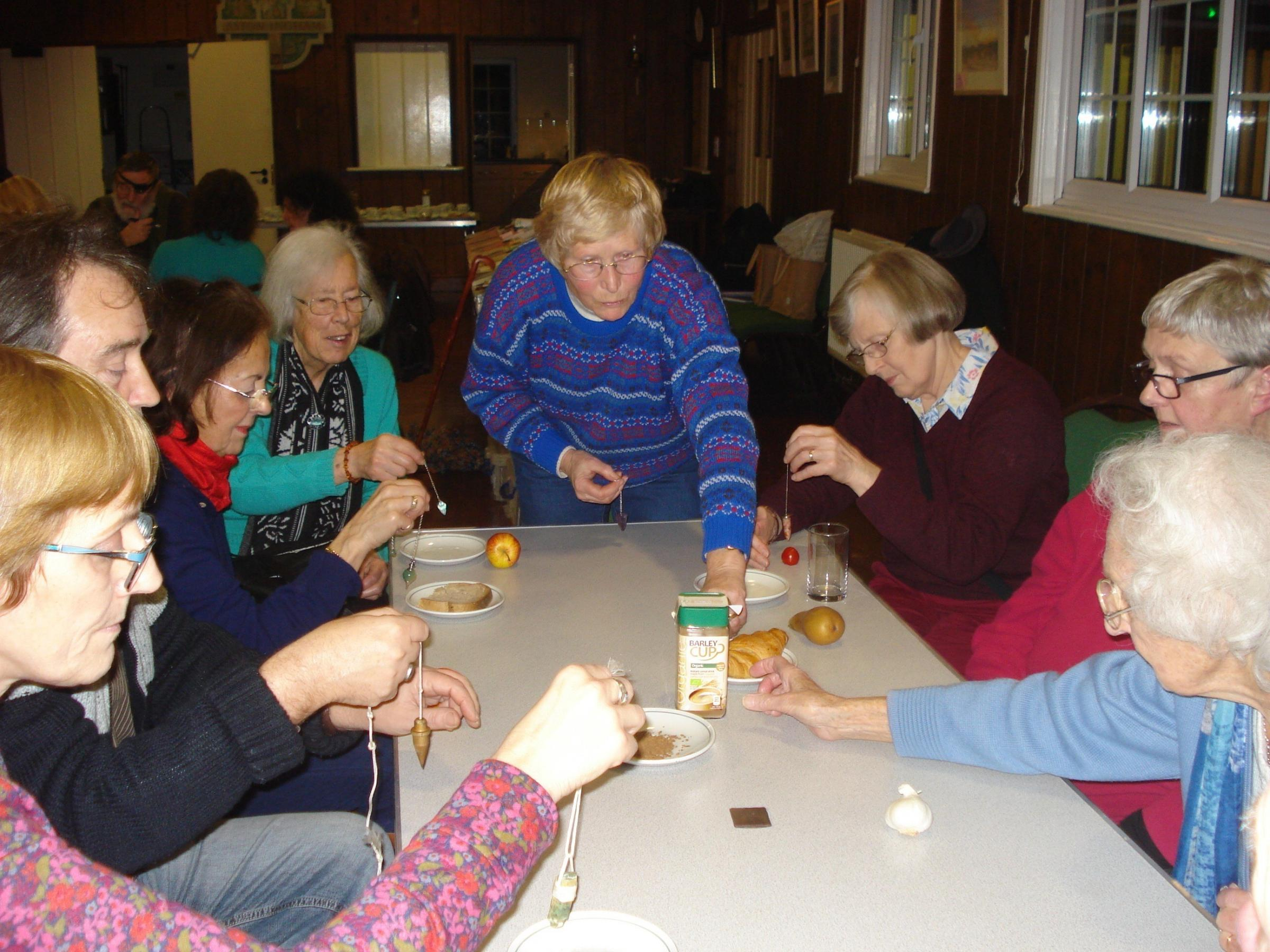 Visitors to a previous 'Four Tables' evening dowse for food intolerances