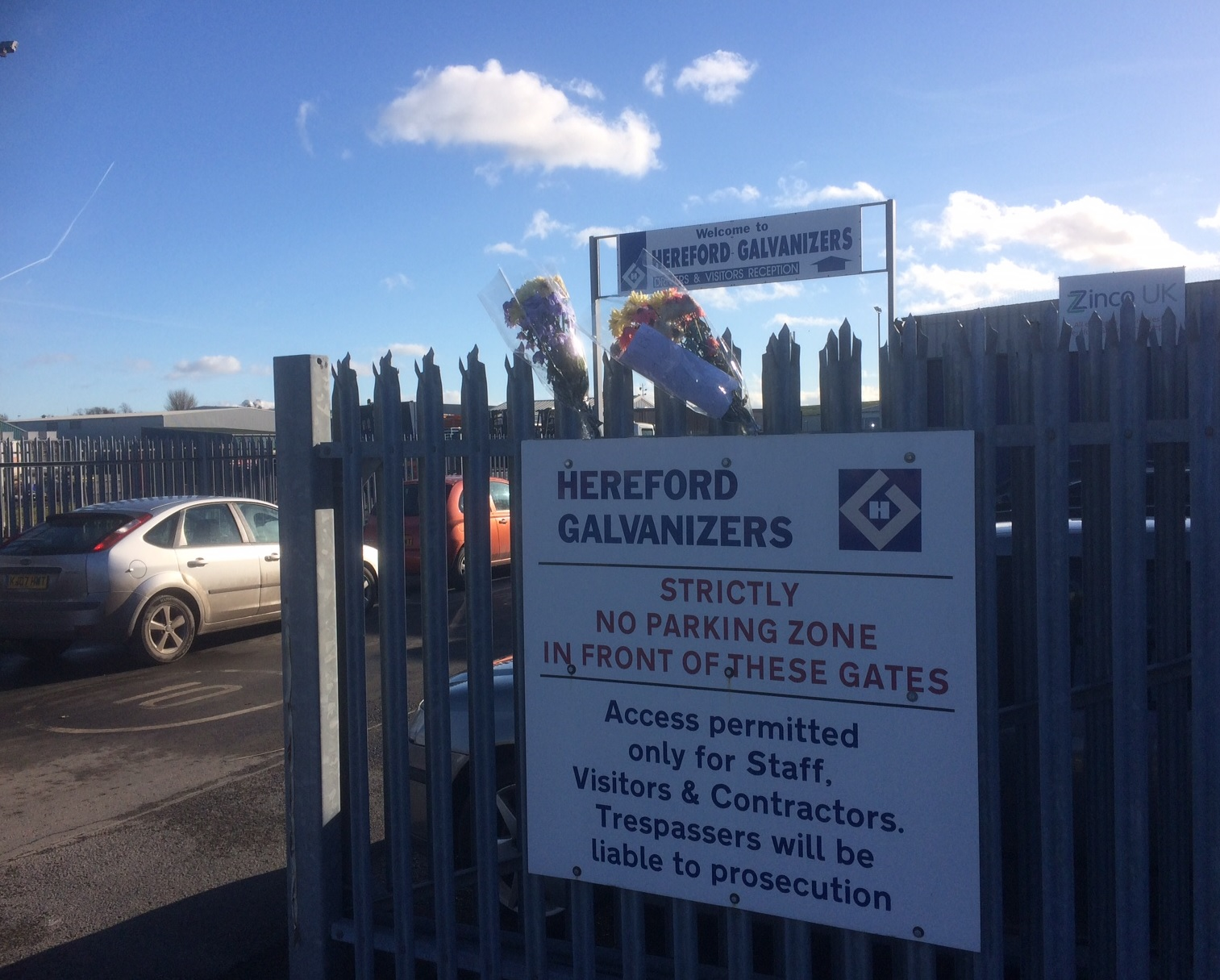 Flowers have been left at the entrance to Hereford Galvanizers. Photo: Ian Morris.