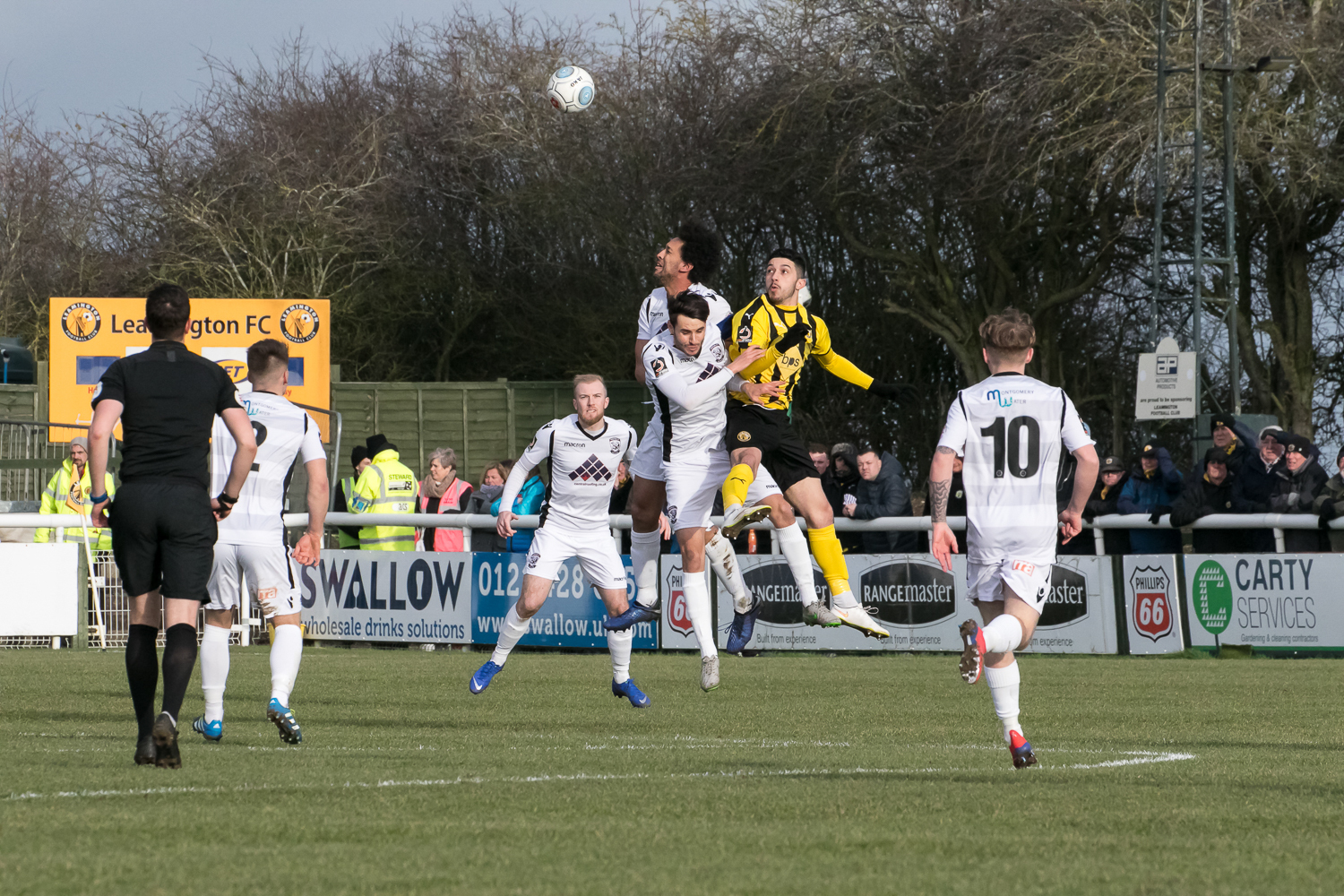 Josh Gowling rises for a header against Leamington. Picture: Andy Walkden/Hereford FC