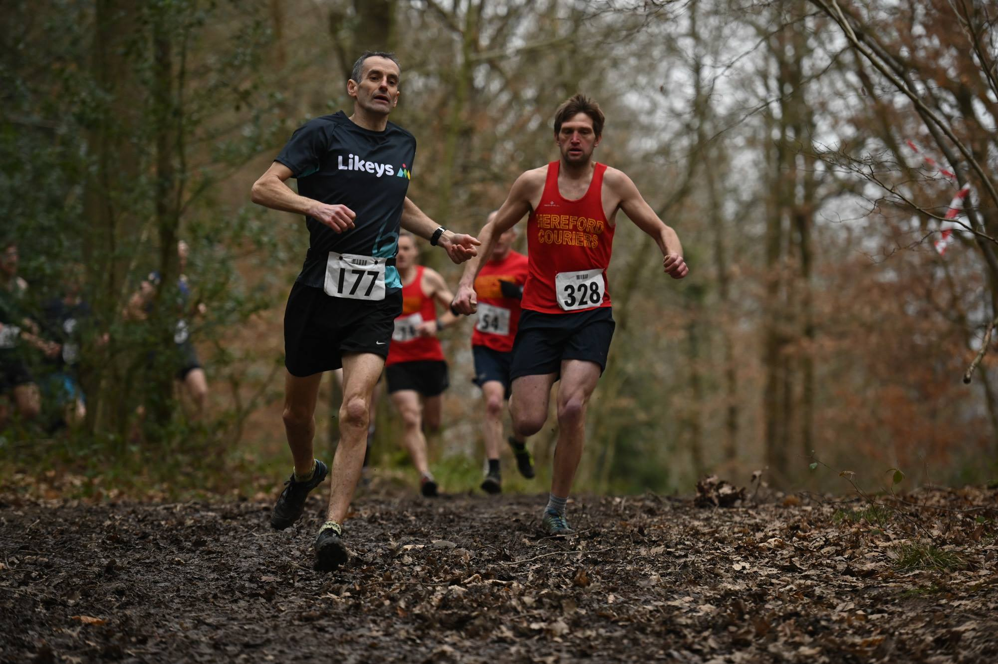 The front of the race was a close battle in the Wye Valley Runners' Muddy Woody 6 race. Picture: Peter Nugent
