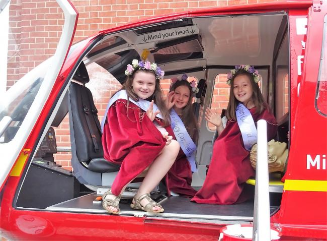 Carnival princess and attendants take a helicopter ride in the Midland Air Ambulance Charity pod at the 2018 event