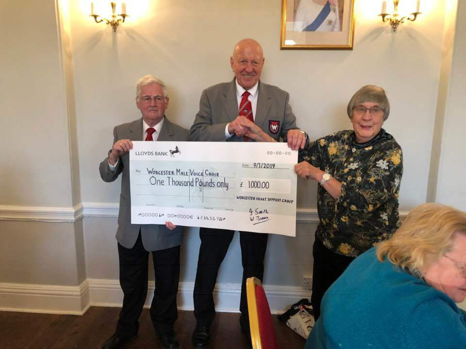 Rob Skinner, the choir's concert secretary and Les Janes, the choir chairman, had the cheque to Pat Whitehead of Worcester Heart Support Group.
