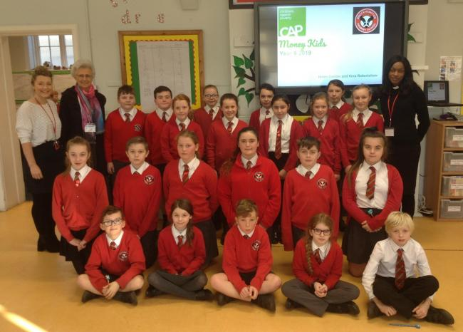 The children from Year 6 with teacher Mrs Hodgkiss and Rev Kina Robertshaw and Helen Combe from CAP