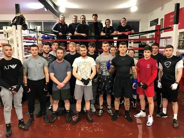 Hereford Sixth Form College Principal Peter Cooper meets some of the members of South Wye Police Boxing Academy