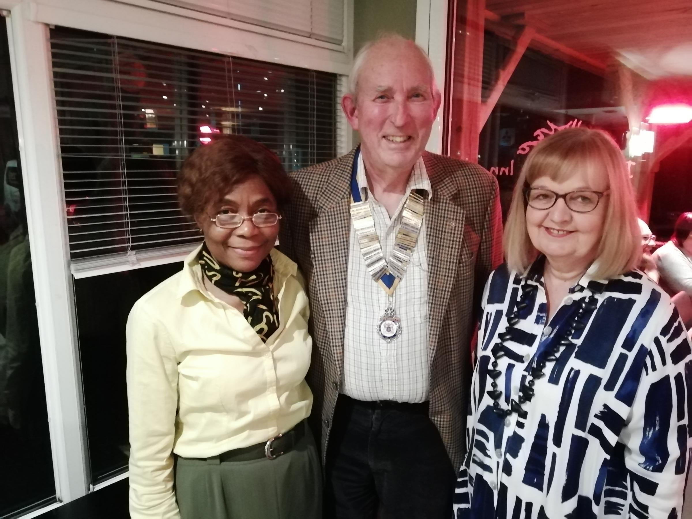 Catherine Chima-Okereke is welcomed into City of Hereford Rotary Club by president Rob Soutar and her sponsor Bobby Morris