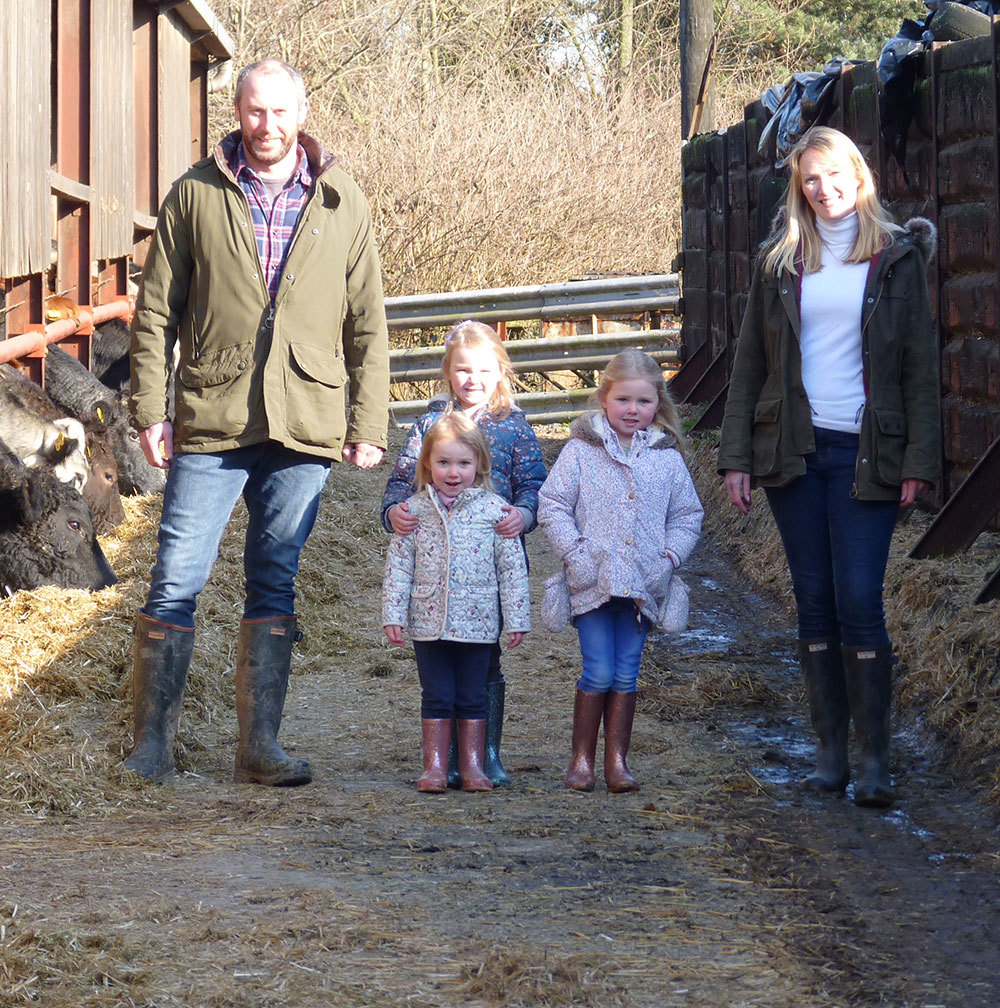 Tom and Julie Davies with their children at Upper Court Farm, Clifford.