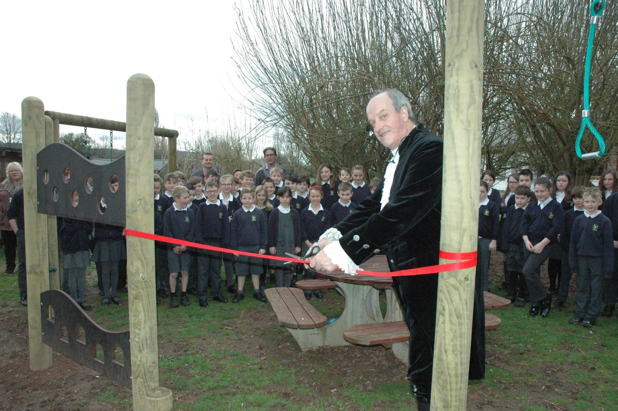 DELIGHTED: High Sheriff Nat Hone declares the play equipment open at Bosbury Primary