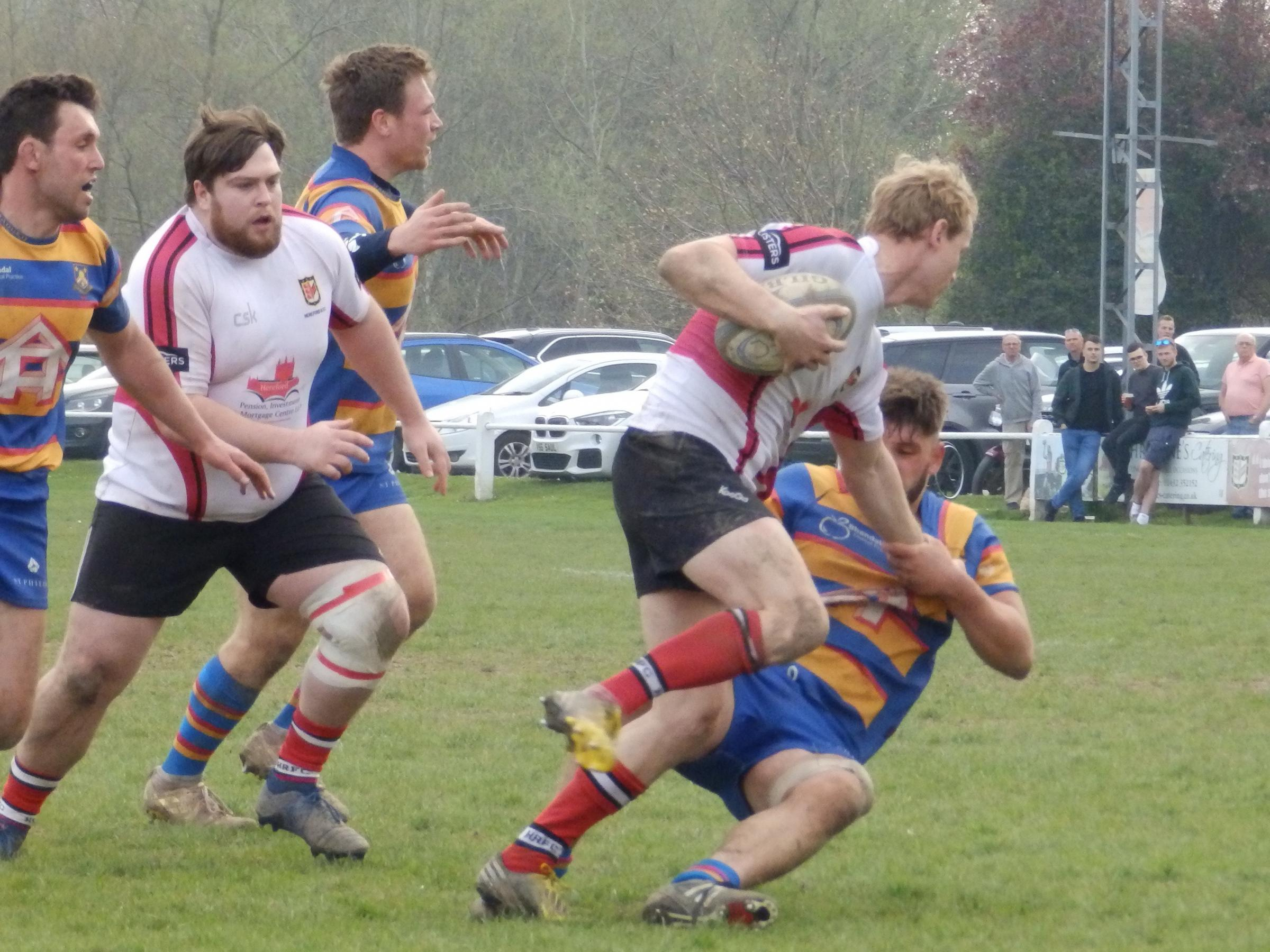 Perry Pudge breaks a tackle for Hereford on their way to victory
