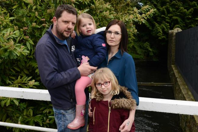 Kington residents Alan and Victoria Thomas with daughters Charlotte and Georjaina. They are struggling to get childcare funding.