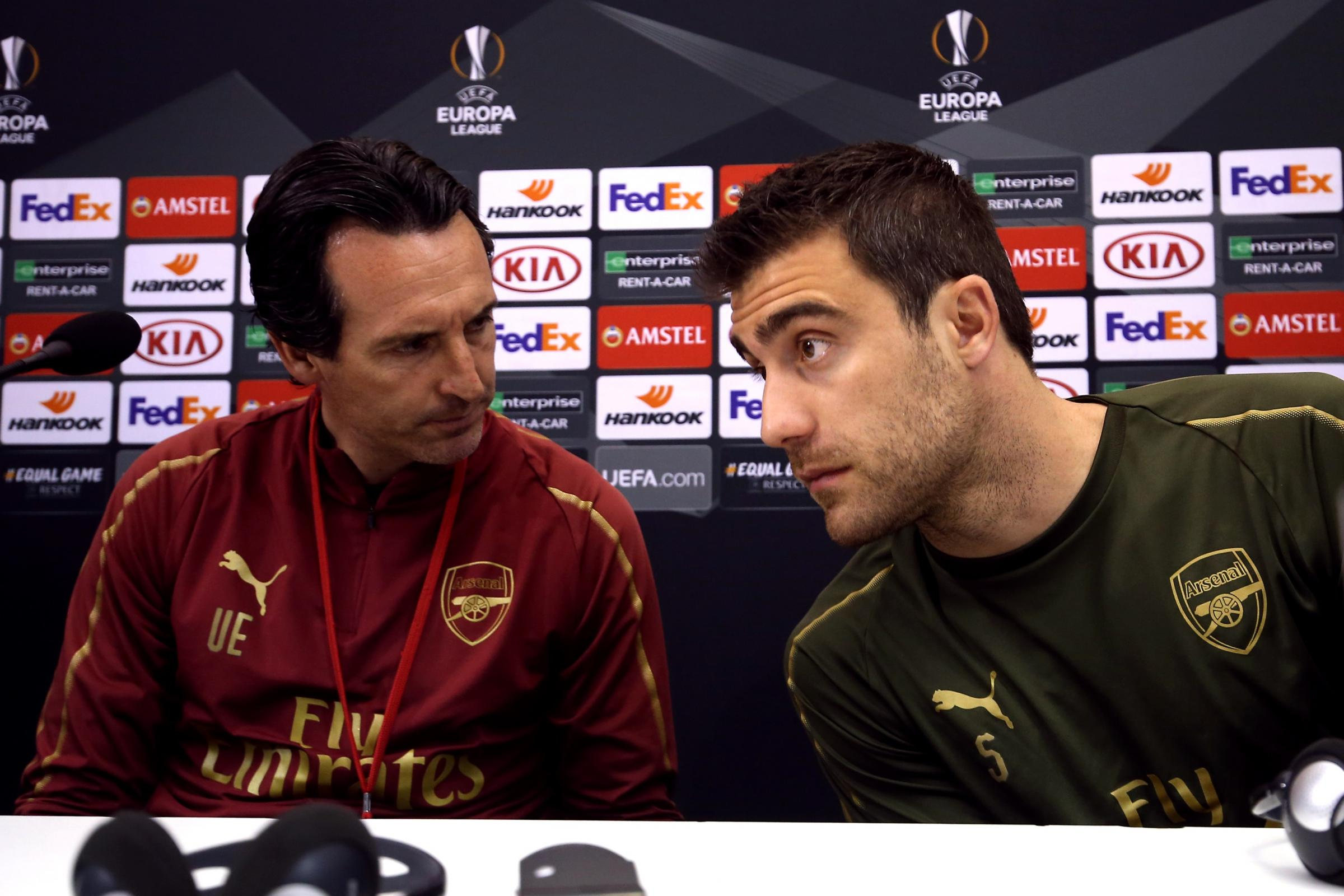 Arsenal manager Unai Emery and defender Sokratis Papastathopoulos address the media