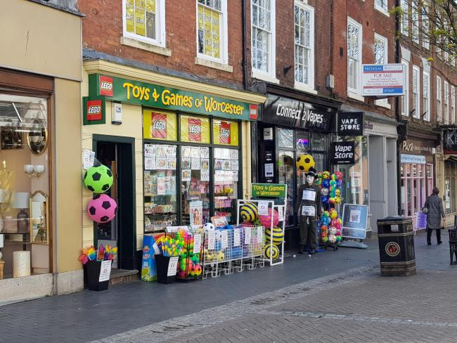 SHOPS: Toys and Games of Worcester and Connect 2 Vapes, with the display outside