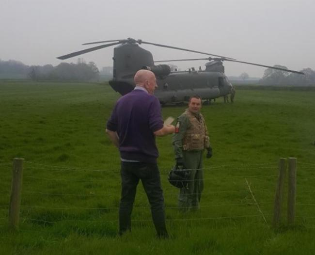 Robert Taylor meets crew from the RAF after it was forced into an emergency landing in Whitney-on-Wye on Tuesday.