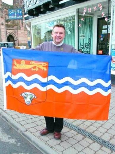 Former Hereford Tourism Information Centre worker Keith Osborne holds an unofficial Herefordshire flag. The quest for a new, official version is nearly complete