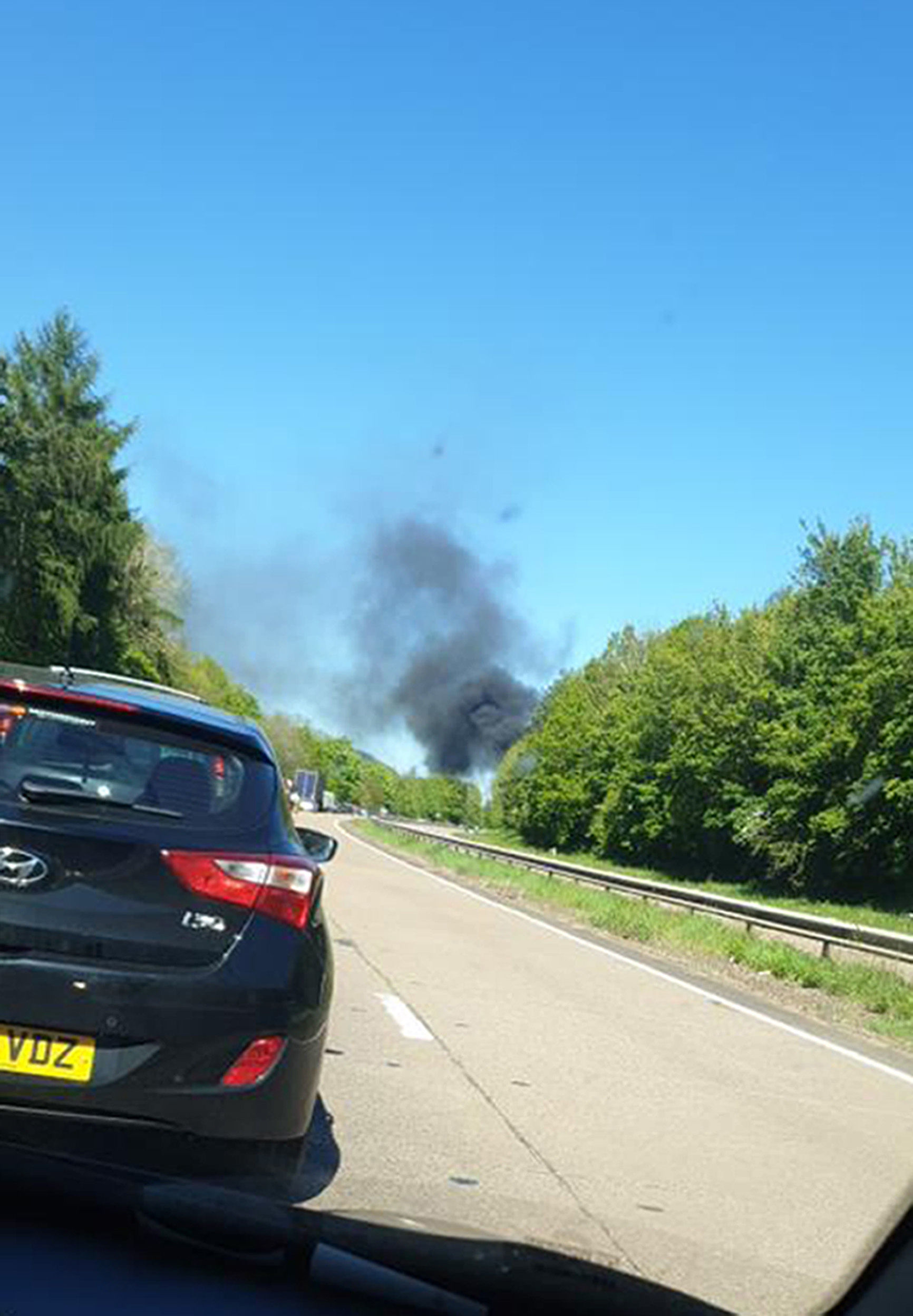 Picture taken with permission from the twitter feed of @Mingles_Bee of smoke rising from the scene of a light aircraft crash on A40 between Raglan and Abergavenny.