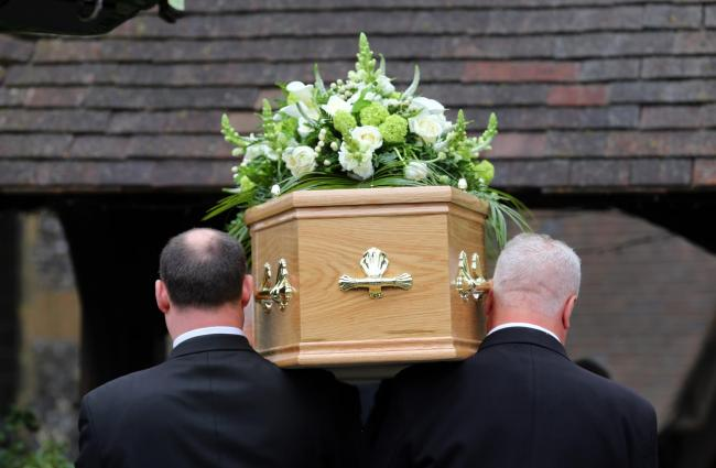 Embargoed to 0001 Wednesday September 04..Undated file photo of a funeral taking place. Bereaved families who struggle with funeral costs are taking on £1,990-worth of debt on average to cover the costs, a report has found. PRESS ASSOCIATION