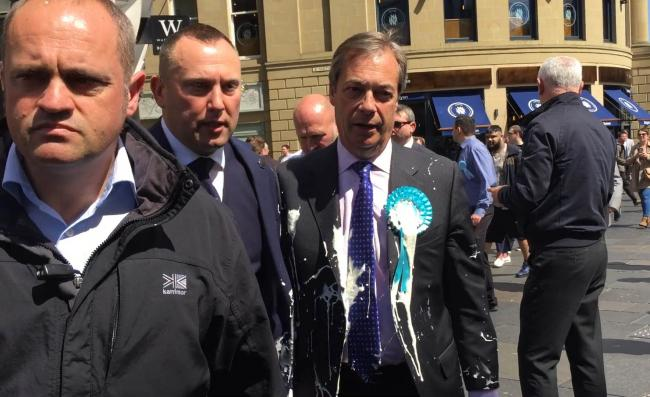 MILKSHAKE: Nigel Farage doused in milkshake after a walkabout in Newcastle. Picture: Tom Wilkinson/PA