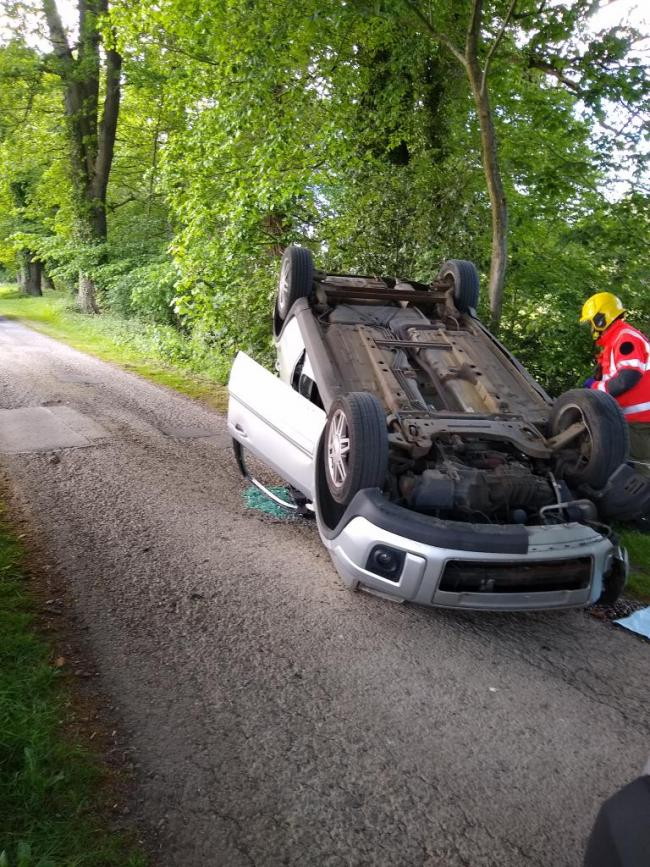 A car overturned after hitting a tree near Leominster. Picture:  @HWFireKingsland