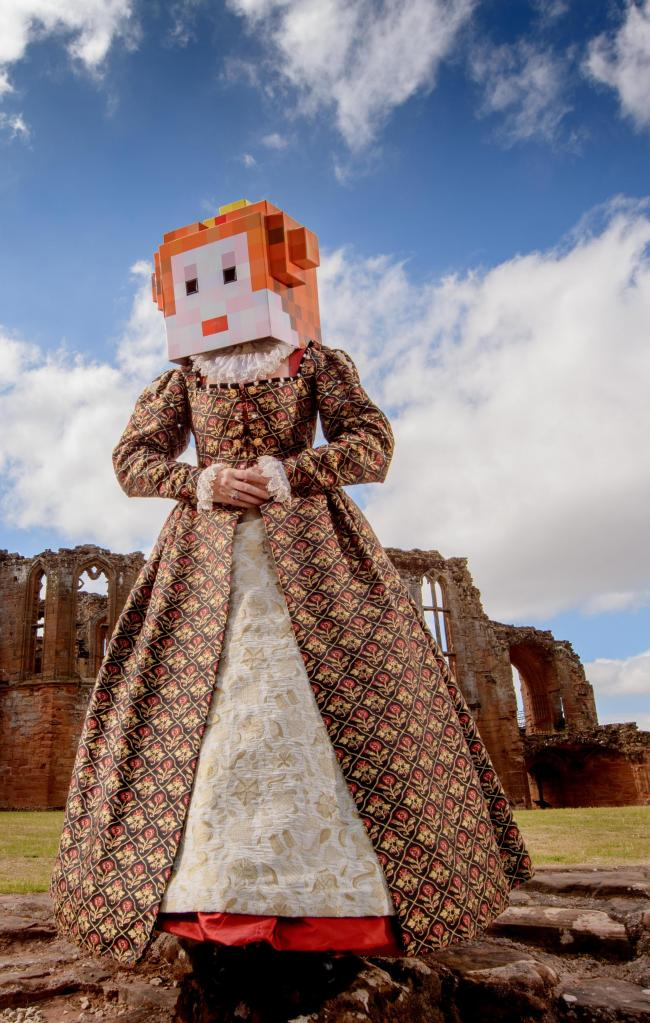 English Heritage is running Minecraft workshops at a number of its castles this summer so that visitors can build some of England's most famous castles in the shadows of the real things. Here an Elizabethan reenactor tries out a Minecraft head for h