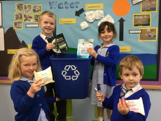 Pupils from Pembridge CE Primary School with their recycling collection bin.